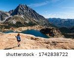 A woman hiker, Mt Stuart, and Lake Ingalls. Alpine Lakes Wilderness, Cascades, Washington, USA