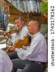 Street band, highlanders playing the violin. Poland, Zakopane, Gubałówka 07.08.2016 - stock photo