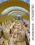 Small photo of PARIS, FRANCE - SEPTEMBER 12, 2013: People in the Musee d'Orsay. Opened in 1986, the museum houses the largest collection of impressionist and post-impressionist masterpieces in the world