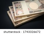 Small photo of Japanese wad of money on a black background