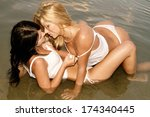 two women in a very erotic... | Shutterstock . vector #174340445