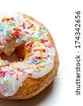 Freshly baked donut with sprinkles - stock photo