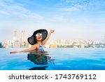 young woman in a roof top... | Shutterstock . vector #1743769112
