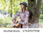 Teen Girl Playing Guitar On Th...