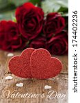 greeting card with roses and red heart shapes  - stock photo