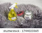 Small photo of Spray white vinegar dilution with water and baking soda (Sodium bicarbonate) in glass jar. Long hair fur carpet cleaning and stain removal, removing smell concept. Natural home cleaners.