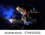 welder with protective mask... | Shutterstock . vector #174410102