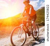 mountain biker on sunny day | Shutterstock . vector #174425822