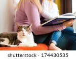 mother reading tired daughter... | Shutterstock . vector #174430535
