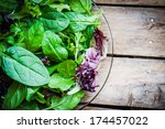 fresh green salad with spinach... | Shutterstock . vector #174457022