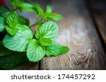 fresh mint on rustic wooden... | Shutterstock . vector #174457292