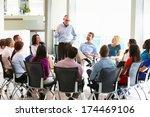 businessman addressing multi... | Shutterstock . vector #174469106