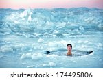 winter swimming. man in an ice... | Shutterstock . vector #174495806