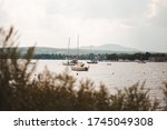 Boats On Magog Lake With Mont...