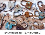 Old Locks And Keys On Wooden...