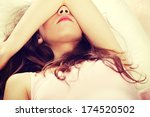 sad woman is lying in bed with... | Shutterstock . vector #174520502