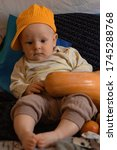 Little Boy With Pumpkin And...