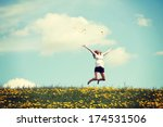 Stock photo happy woman jumping on blossom meadow beautiful day on field 174531506