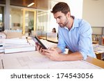 male architect with digital... | Shutterstock . vector #174543056