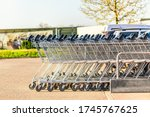 Many Metal Shopping Carts On A...