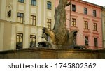 Neptune Fountain statue sculpture robust figure landmark historical monument memorial 1683, depicts Roman god of seas, baroque style trident, tank water spouting spring, architecture city Olomouc