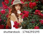 Beautiful Woman With Red Rose...