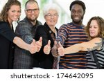 college students giving thumbs... | Shutterstock . vector #174642095