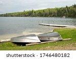 Overturned rowboats near a dock ...