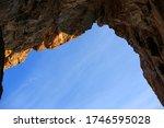 Blue Sky Through A Hole In The...