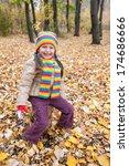 girl sitting on stump in autumn ... | Shutterstock . vector #174686666