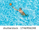 Man Play In The Pool With A...