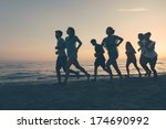 Group Of People Running On The...