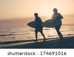 two boys with surf boards at... | Shutterstock . vector #174691016