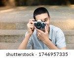 Young Teenage Boy Photographin...