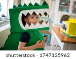 Smiling boy wearing a cardboard ...