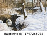 Snowy Path And Stream Next To A ...