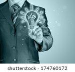 business man touching light of...   Shutterstock . vector #174760172