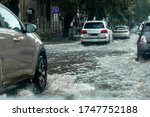 Riving Car On Flooded Road...
