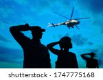 Silhouettes Of Soldiers In...