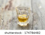 a small glass of whisky on wood ...   Shutterstock . vector #174786482