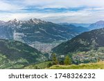 View of Chur, the town of the Alps in Switzerland, nested at the bottom of the valley