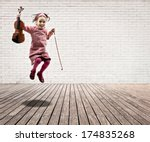 Little Girl With Violin Jumping ...