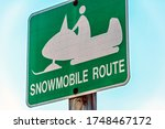 A Snowmobile Sign Indicating A...