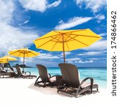 sun umbrellas and chairs on...   Shutterstock . vector #174866462