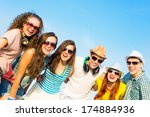 group of young people wearing... | Shutterstock . vector #174884936