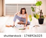 Young Brunette Woman Creating...