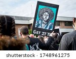 """Small photo of A man holds a sign with an image of sports icon Colin Kaepernick asking """"Get It Yet?"""" - June 2, 2020: Black Lives Matter Protest at Clifton City Hall - Clifton, NJ"""