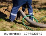 Man Worker Holding Pipe ...