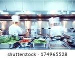 motion chefs of a restaurant... | Shutterstock . vector #174965528