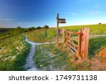 Wooden Sign And Gateway On A...